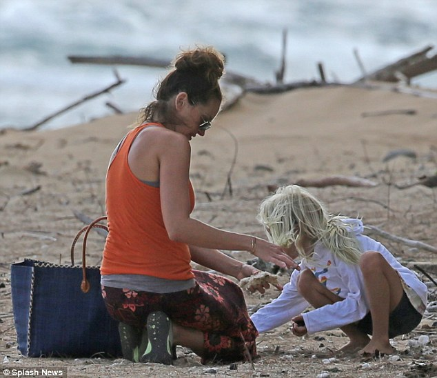 Pretty Woman's mini-me: Julia Roberts bonded with her daughter Hazel while collecting shells along the beach last week In Kauai, Hawaii
