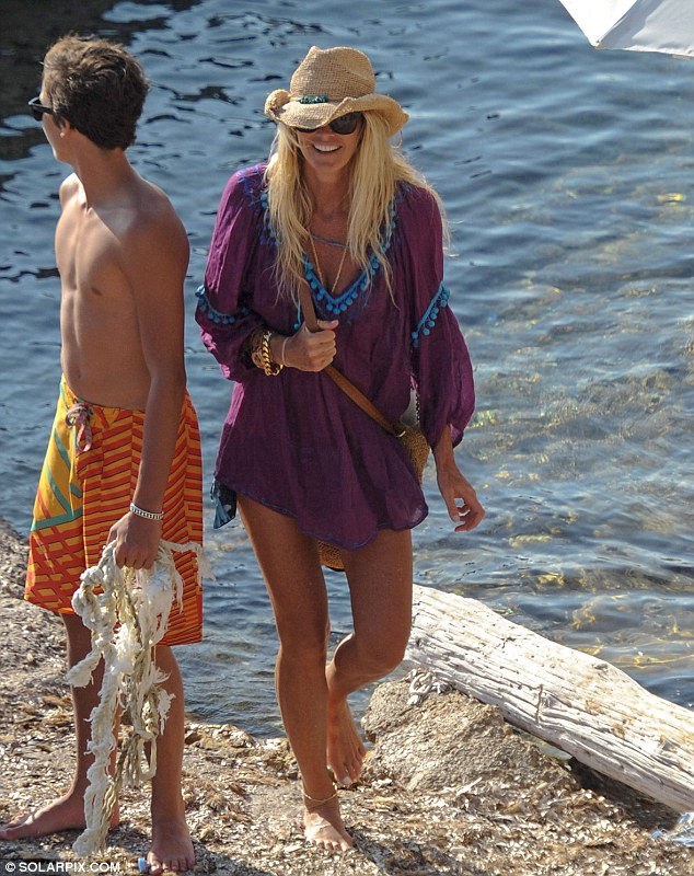 Back on shore: Elle had enjoyed an afternoon on the sea with her two boys and reportedly her new boyfriend Roger Jenkins