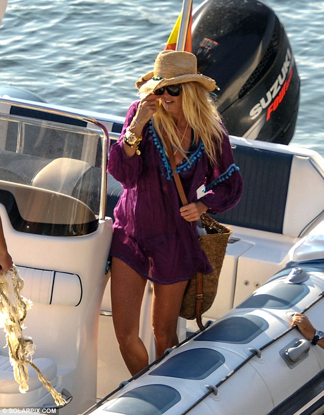 Gold star: The model looked amazing as she prepared to leave the boat she had spent all afternoon relaxing on