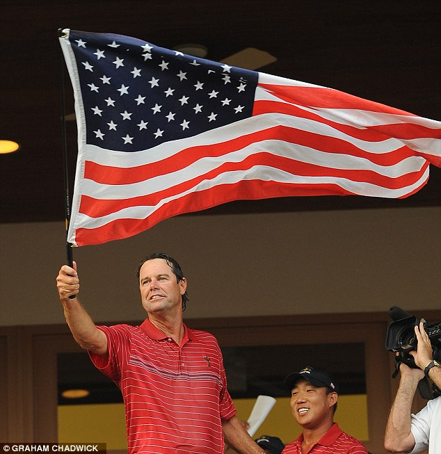 Patriot games: Azinger waves the stars and stripes after their Ryder Cup victory