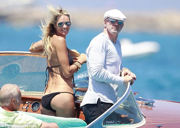 Body beautiful: Elle Macpherson showed off her age-defying shape in a small black bikini as she enjoyed a boat ride with her boyfriend Roger Jenkins  in Ibiza today