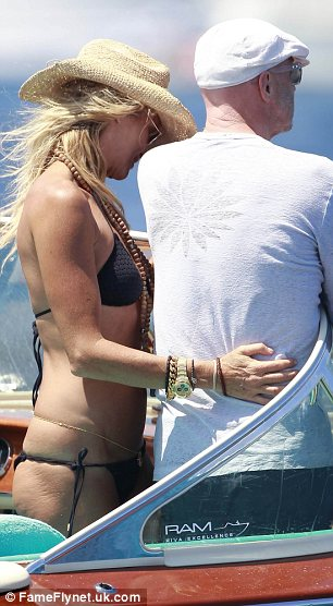 She's still got The Body: The Australian model was seen cuddling her beau Roger Jenkins as the pair looked out to sea