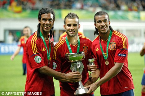 Cup of joy: Spanish players Jonas Ramalho, Jese Rodriguez, and Derik Osede hold the trophy