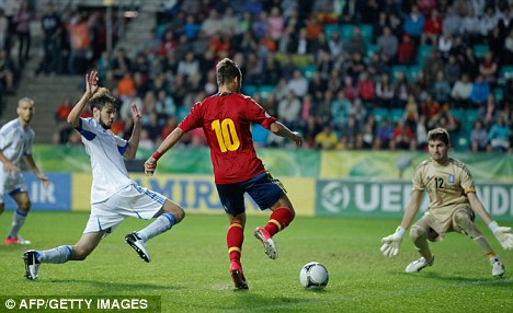 In on goal: Jese Rodriguez vies for the ball with Greek goalkeeper Sokratis Dioudis