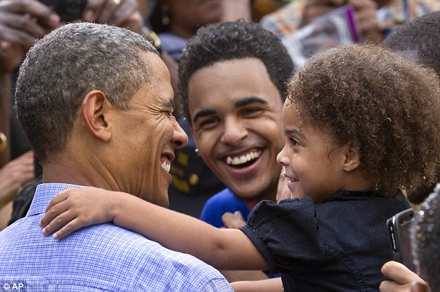 Grin and bear it: The President's fans were happy to brave the rain