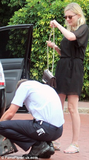 took a turn for the sombre: Kirsten changed into a short black dress to leave her hotel later