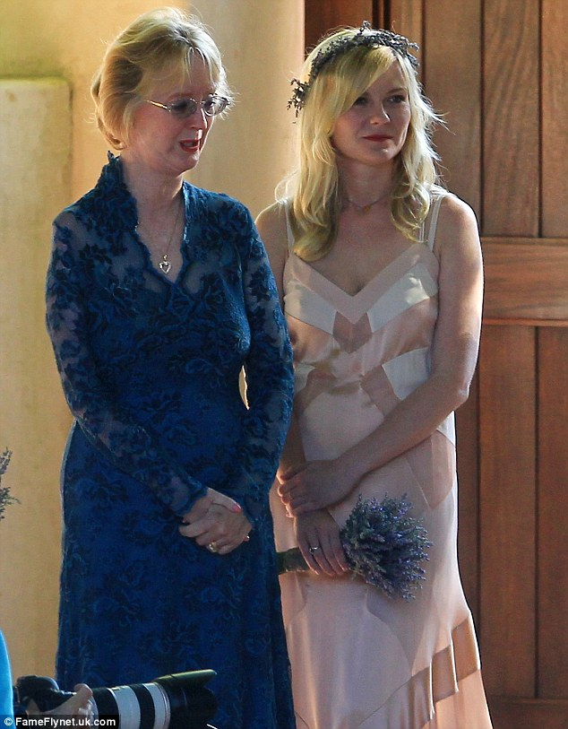 Hung out with mum: Kirsten appeared to be standing with the mother of the bride for a while