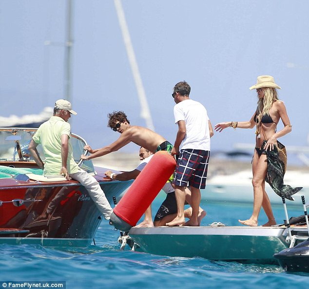 Not a bad trip: Elle was seen strutting her stuff in the minimal outfit as she swapped for her big yacht to a small speed boat