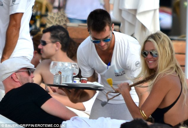 Let's have a tipple: The couple spent the day at Blue Marlin in Ibiza
