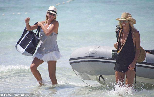 Making a splash: The Australian model looked great in her plunging black vest over her dark bikini