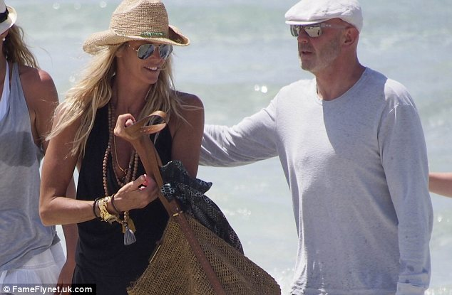 Heading out for food: Elle and her boyfriend got off their luxury yacht to grab a bit to eat on the beach