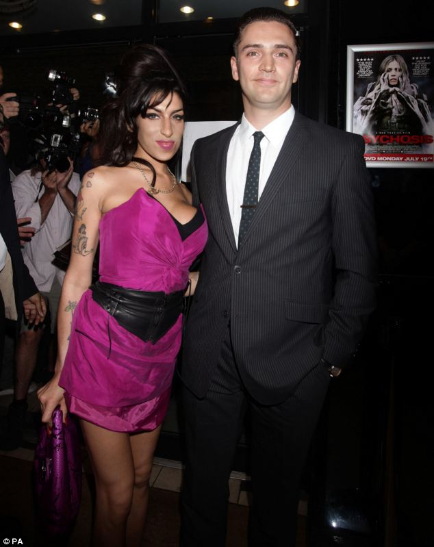 Happier times: Traviss and Miss Winehouse arriving for the premiere of his film Psychosis, at the Prince Charles Cinema in Leicester Square