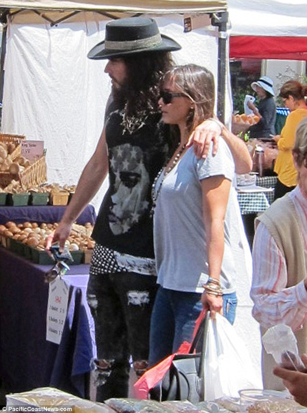 Moving on: Russell Brand was seen strolling with her latest squeeze Isabella Brewster (sister of actress Jordana) at Pacific Palisades Market yesterday