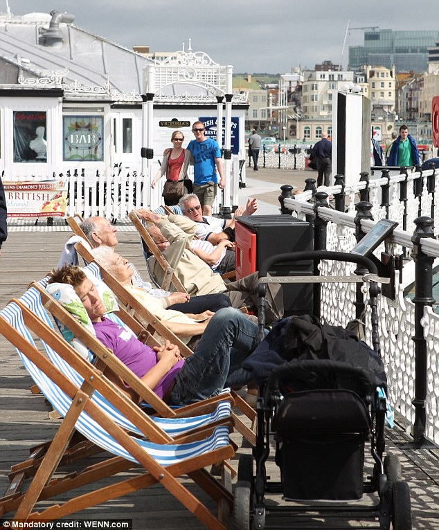 Sunbathers enjoy the sunny weather in Brighton