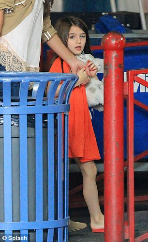 Their little girl: Katie is believed to have won sole custody of Suri in their divorce settlement