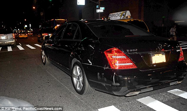 Damage: A Mercedes S550, believed to have been chauffeuring Katie and Suri, was struck by a sanitation truck in New York City