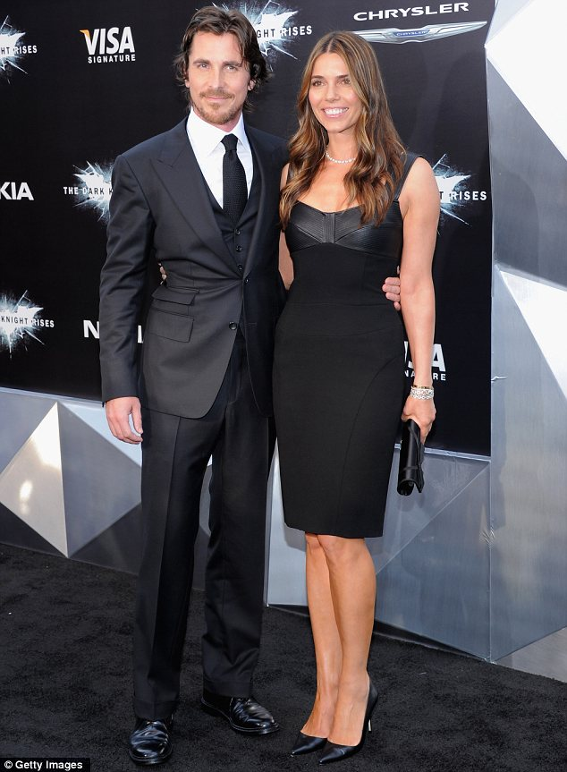 Suave superhero: The film's star Christian Bale sported a classic black suit and his wife Sibi Blazic matched n a form-fitting black dress