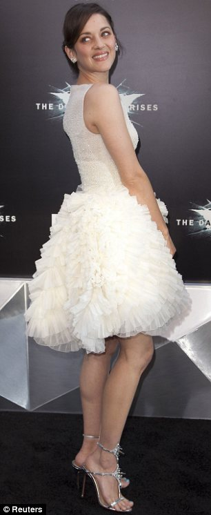 Ruffling feathers: Marion Cotillard paraded her pins in her youthful cream frock which had a net skirt
