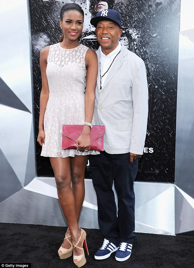 Power couple: Russell Simmons sported a striped jacket and baseball cap and had Miss Universe Leila Lopes on his arm
