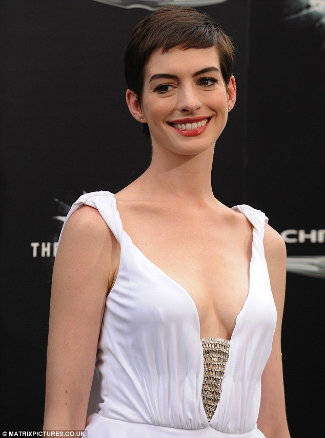 Feline sexy! Anne Hathaway, who stars as Catwoman in The Dark Knight Rises, wore a sexy plunging white dress to the premiere of the movie in New York last night