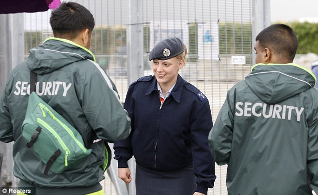 Crisis: A member of the RAF checks the identification details of two G4S security guards at an exit to the Olympic Park in Stratford, east London