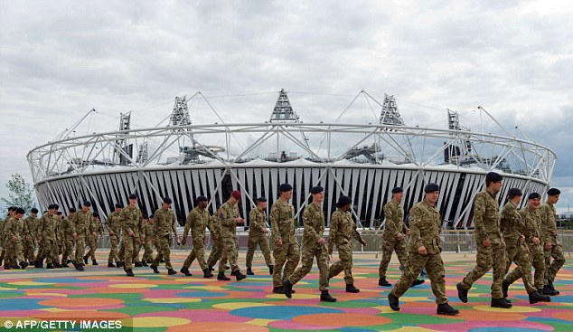 Filling in: Members of the Armed Forces are shown around the site of the Olympic Park. More service personnel had to be drafted in after G4S failed to provide enough security guards
