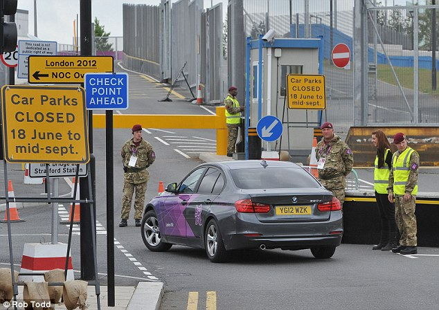 'Shambles': Soldiers man a checkpoint at the Olympic village in Stratford, east London. MPs heard that G4S has only 4,200 staff ready to work at Games venues