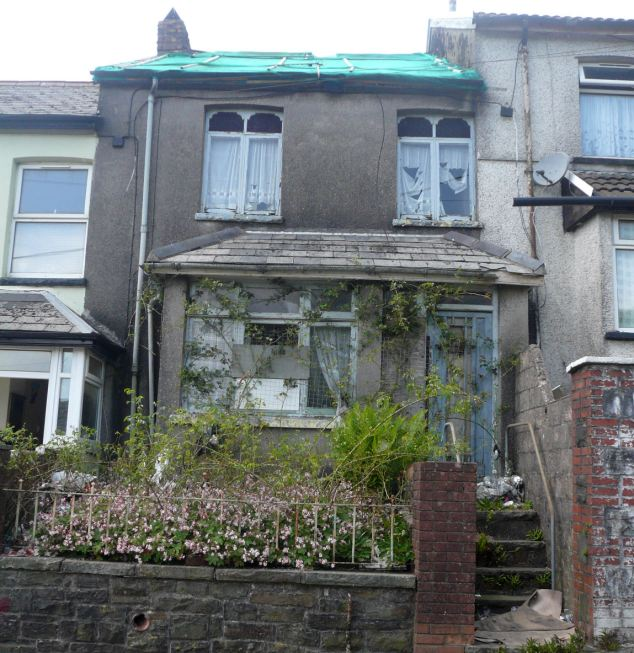 Britain's cheapest house in Oak Street, Tonypandy in South Wales, is on offer for £4,000.