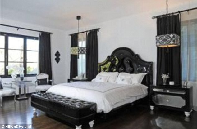 Master suite: The striking black and white coloured bedroom has two bathrooms leading off of it