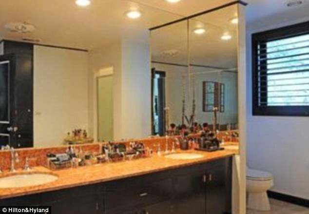 Beauty queen: The counter in the master bathroom features a wealth of make up and beauty products