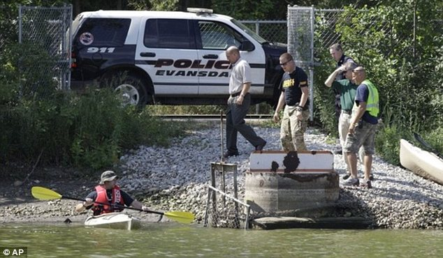 Desperate search: Authorities look for possible evidence at Meyers Lake where Lyric Cook-Morrissey, 10, and Elizabeth Collins, 8, disappeared last Friday