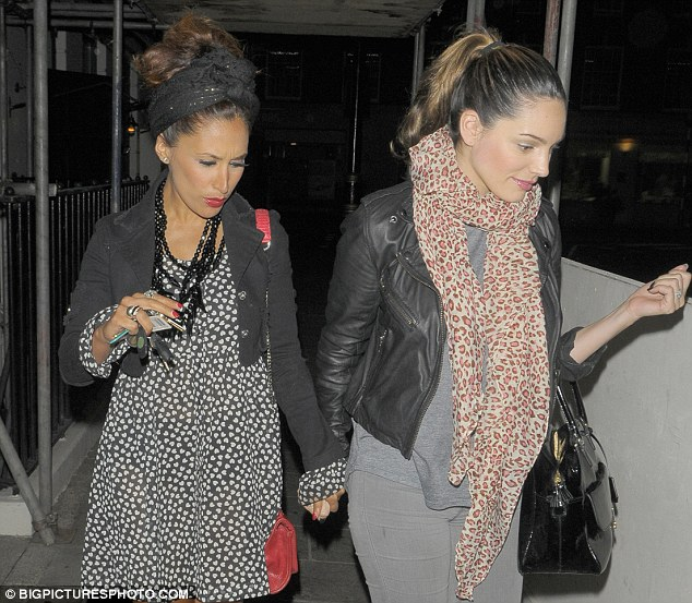 Hand in hand: Brook and Kalidas left the Mayfair venue holding hands and chatting away