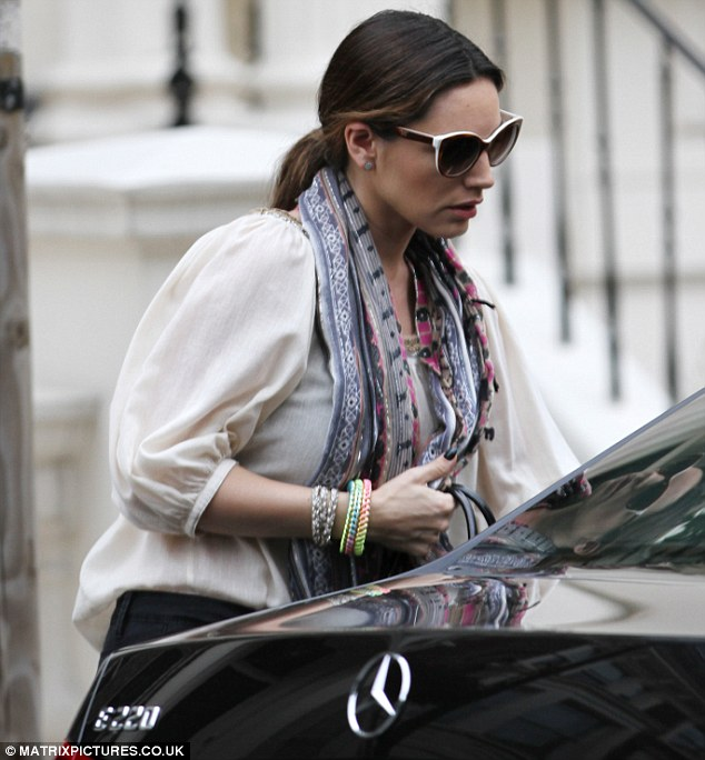 Something to hide? The brunette wore a pair of large sunglasses as she made her way into her car