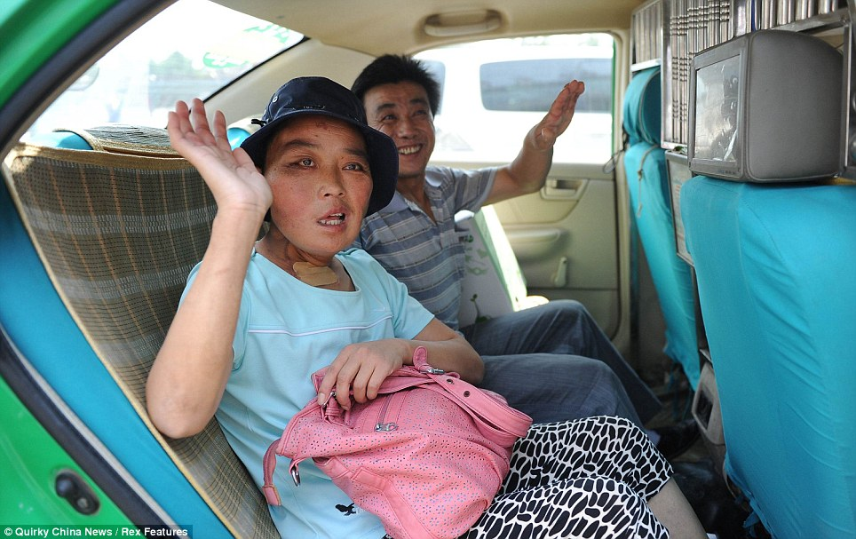 Ms Li and her husband Guo Yingping, 40, wave goodbye as they leave the hospital in Xian