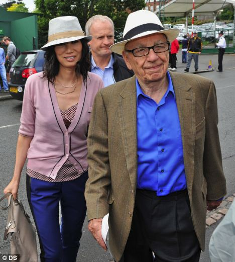 Heading for the exit? Billionaire News Corporation chairman Rupert Murdoch with wife Wendi