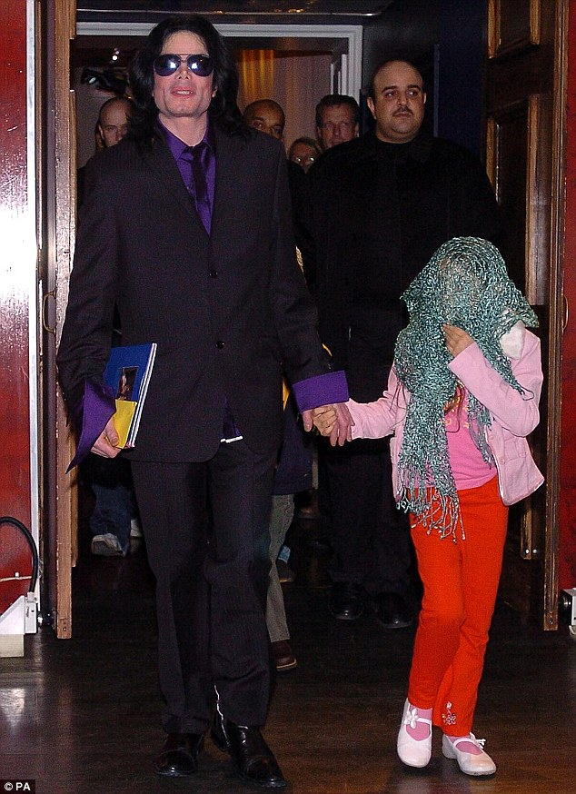 Covering up: Michael Jackson, seen here in May, 2005, famously threw a covering over his daughter's head whenever they were in public so she could not be identified