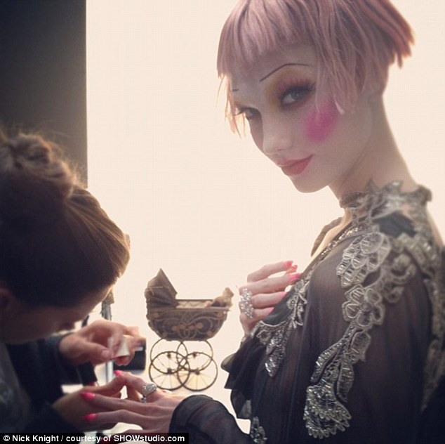 Last minute refining of Karlie Kloss' nails before she steps on set looking in Valentino