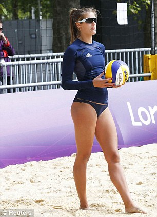 Practical: Volleyball players Shauna Mullin and Zara Dampney will keep their revealing bikini outfits as they are 'perfect for the sport', but may be forced into long-sleeved top (right) and shorts if the weather turns