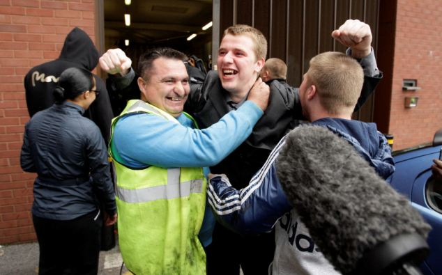 Ryan Goodwin, centre, celebrates being aquitted in the Winson Green triple death trial and is is greeted by friends and family as he leaves Birmingham