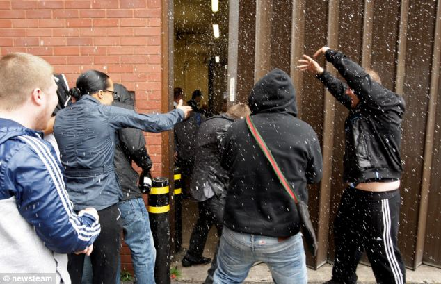 Champagne showers: The newly acquitted are sprayed with champagne after all eight were found not guilty of murder