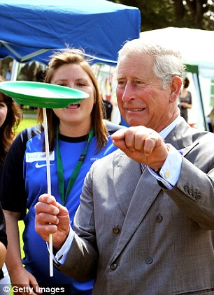 Nervous: Prince Charles doesn't look confident as he holds up a spinning plate