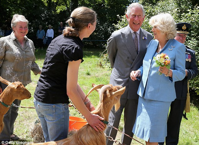 Is that posy my lunch?: The couple share a joke as the Duchess lifts her flowers to safety