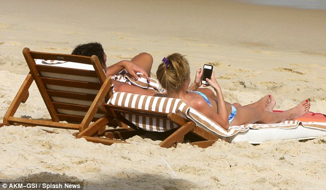 Texting: While Andy seemed to be enjoying the active elements of his holiday, Stacey was more concerned with her mobile phone
