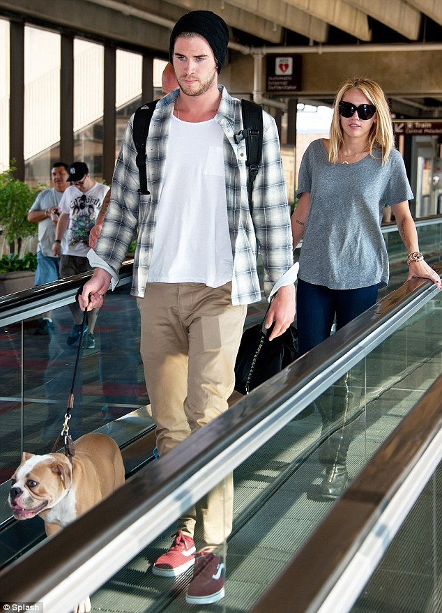 Domestic bliss: The young couple were seen arriving at Philadelphia International Airport on Tuesday