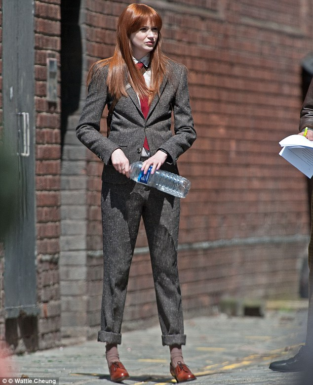 Suited and booted: Karen Gillan looked chic in an androgynous grey tweet suit