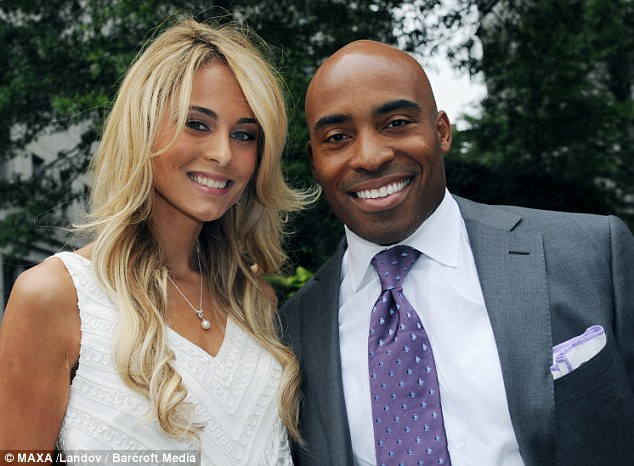 Tiki Barber, former New York Giant running back and fiance, Traci Lynn pose for pictures before their wedding