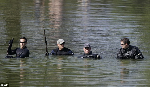 Extra search: On Friday an FBI squad searched Meyers Lake for missing children Lyric Cook-Morrissey, 10, and Elizabeth Collins, 8, who disappeared last week in Iowa