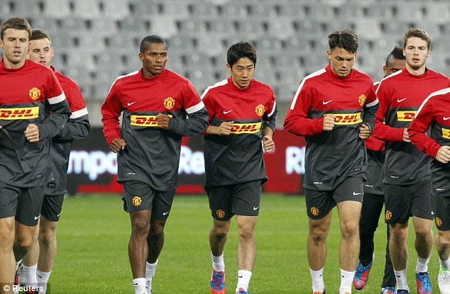 One of the boys? Will Robin van Persie be joining new summer arrivals Shinji Kagawa (fourth left) and Nick Powell (right) at Old Trafford?