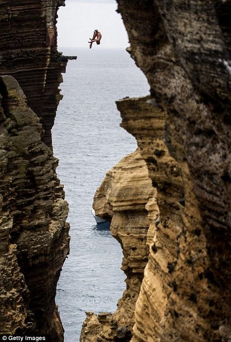 Tom Daley's former diving partner Blake Aldridge dives 29 metres from the rock monolith