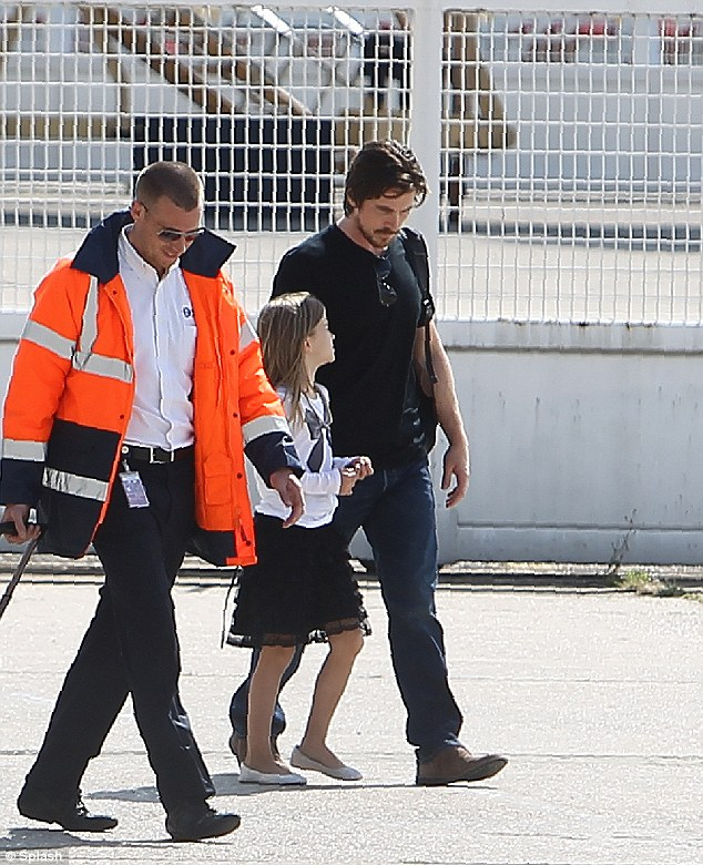 Christian Bale and his daughter are seen leaving Paris after the premier of 'The Dark Knight Rises' was cancelled follow the tragedy in Aurora, Colorado